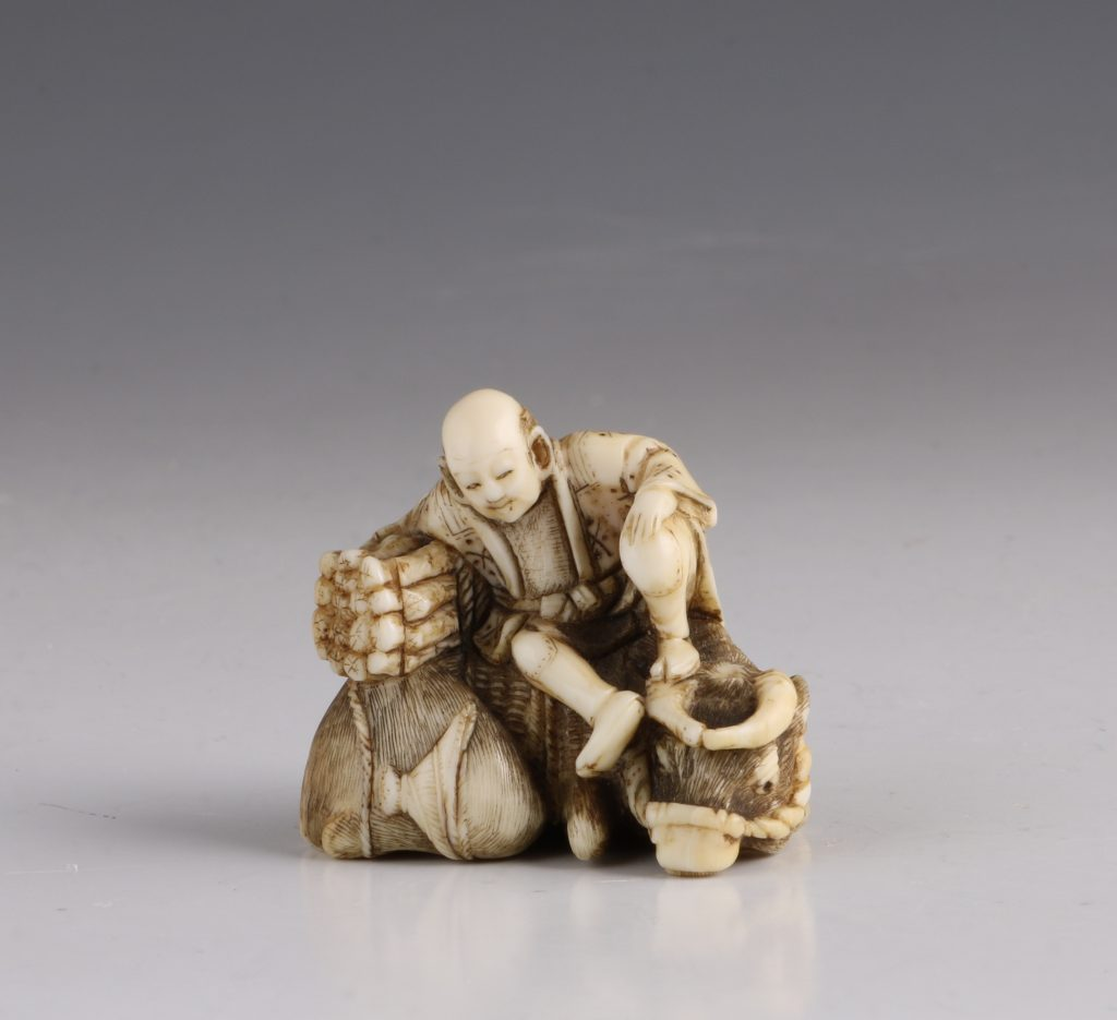 Japanese Ivory Netsuke of a Woodcutter and his Buffalo 19thC