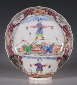 A Famille Rose Acrobats Teabowl and Saucer Qianlong