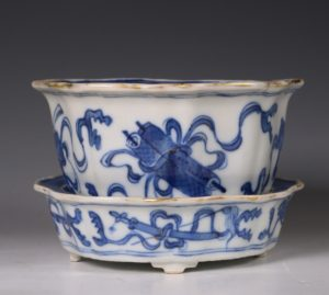 A Small Blue and White Jardiniere and Stand Kangxi C1700