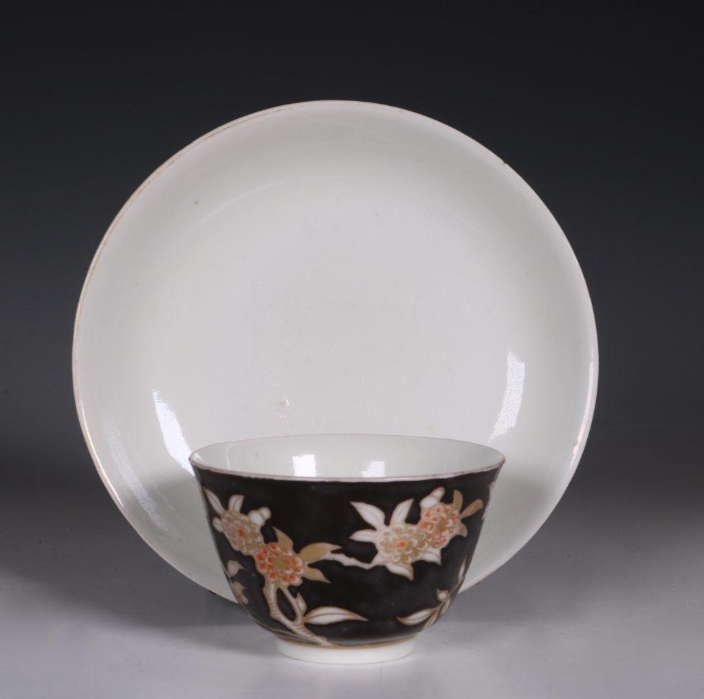 A Rare Japanese Arita Black Ground Teabowl and Saucer E18thC 1