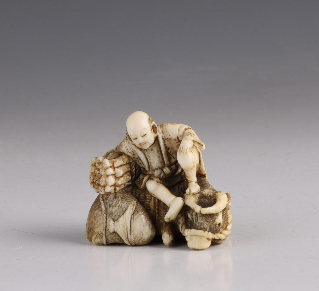 Japanese Ivory Netsuke of a Woodcutter and his Buffalo 19thC