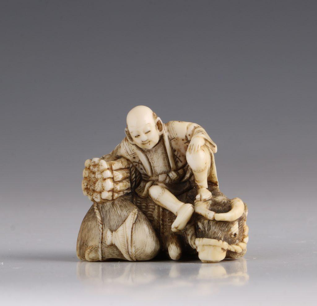 Japanese Ivory Netsuke of a Woodcutter and his Buffalo 19thC 1