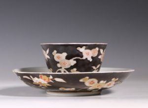A Rare Japanese Arita Black Ground Teabowl and Saucer E18thC