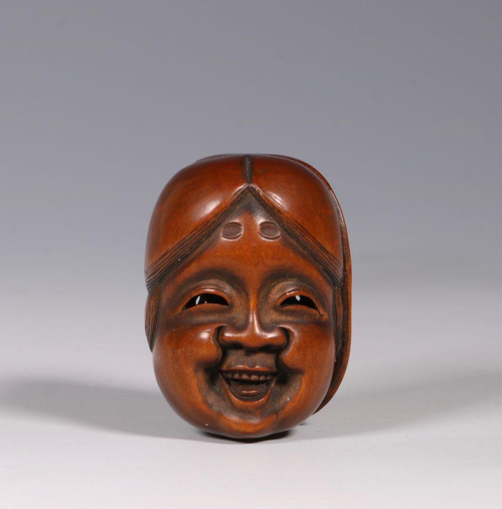 A Boxwood Mask Netsuke 19thC