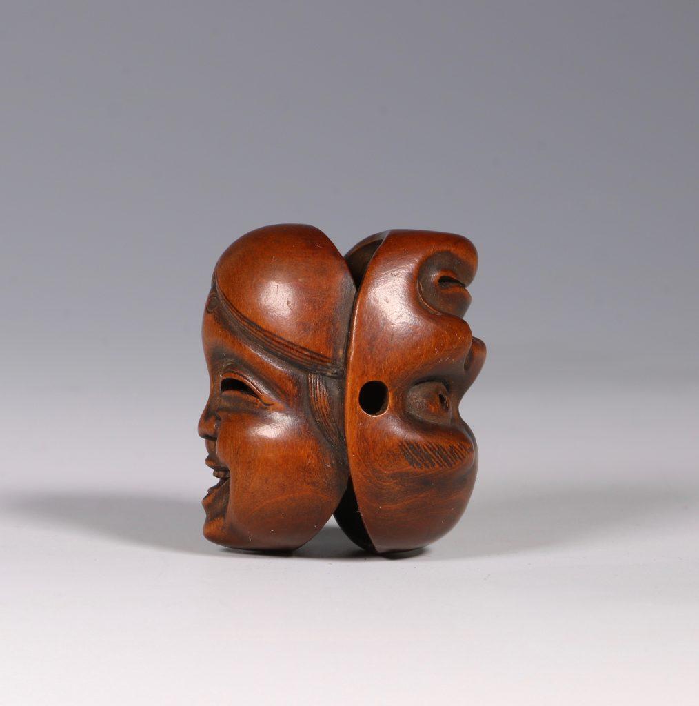 A Boxwood Mask Netsuke 19thC 2