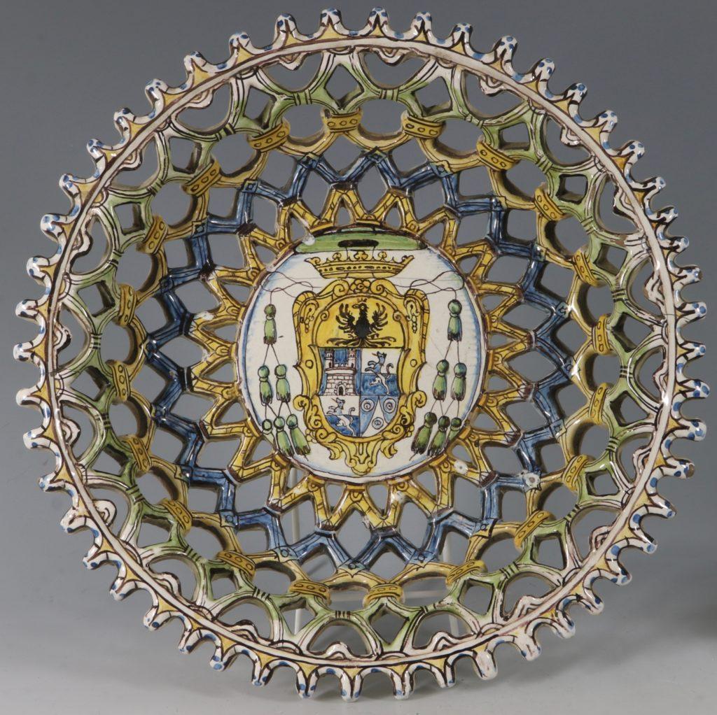 An Italian Maiolica Pierced Footed Armorial Dish 17thC