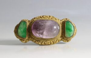 A Chinese Gilt Bronze Belt Buckle Inset with Amethyst and Jadeite 18/19thC