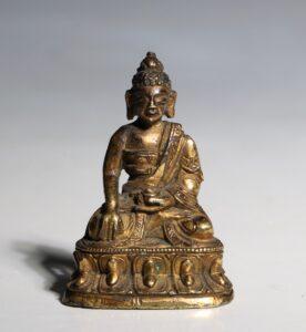 A Miniature Sino Tibetan Gilt Bronze Figure of Shakyamuni Buddha 18/19thC