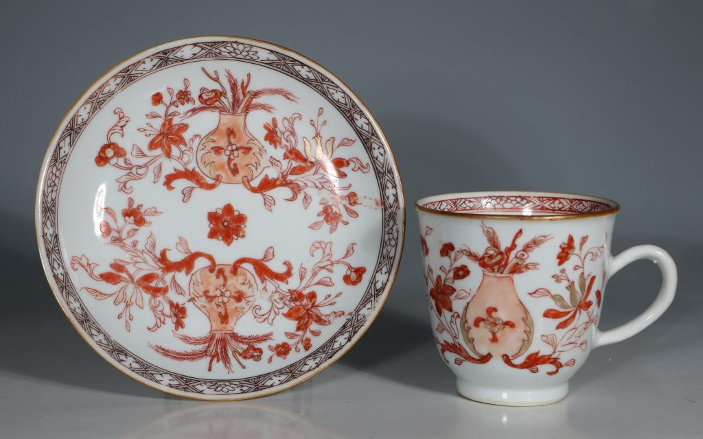 An Iron Red Decorated Coffee Cup and Saucer 18thC