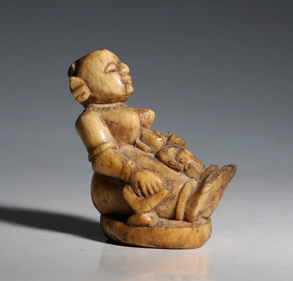 A Stag Antler Figure of a Mother and Child Eastern India 17/19thC