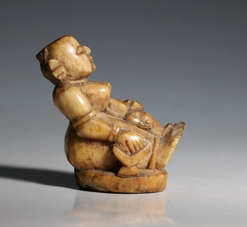 A Stag Antler Figure of a Mother and Child Eastern India 17/19thC 1