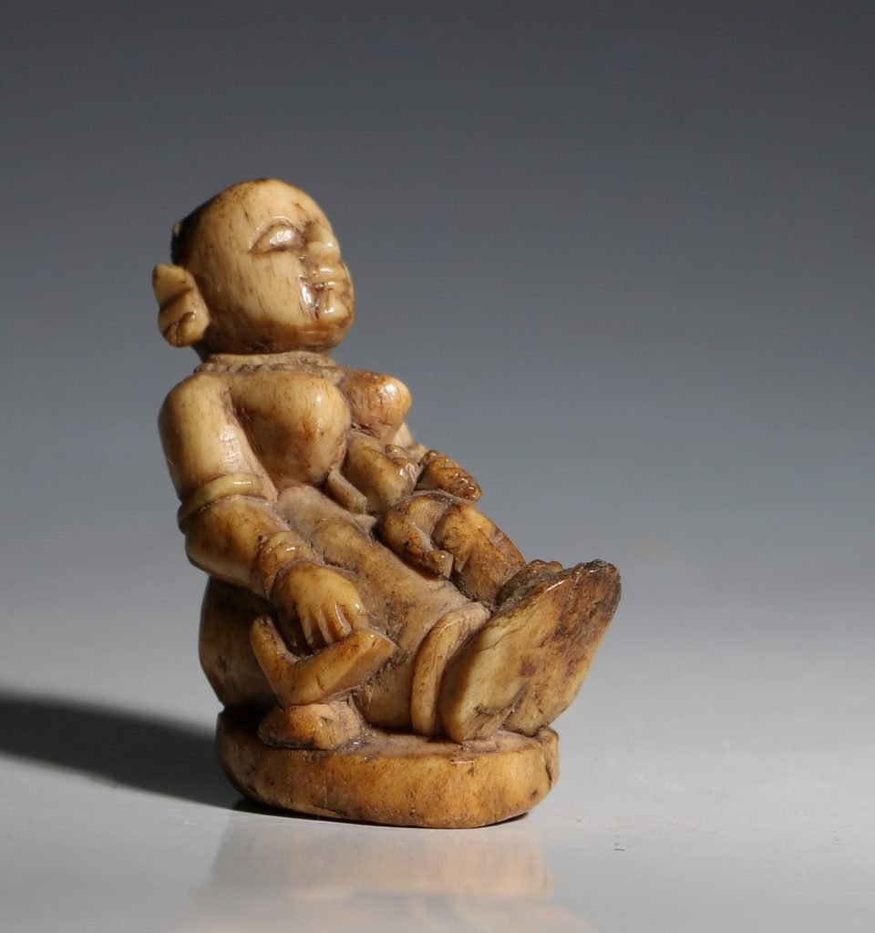 A Stag Antler Figure of a Mother and Child Eastern India 17/19thC 2