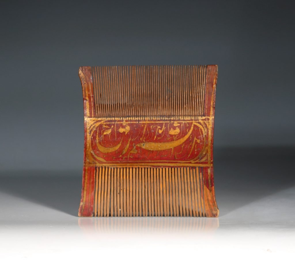 A Qajar Lacquered Comb 1