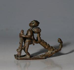 An Ashanti Goldweight of a Leopard Attacking a Man 19thC